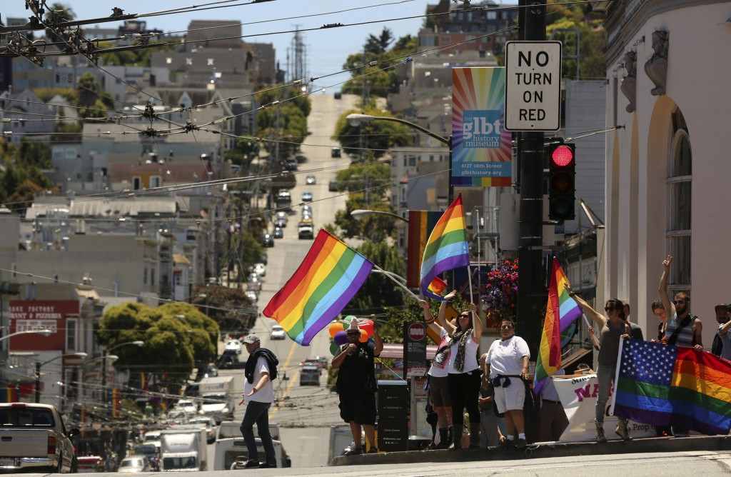 Same-sex marriage supporters wave flags in the Castro neighborhood in San Francisco